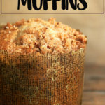 A coffeecake muffin on a board.