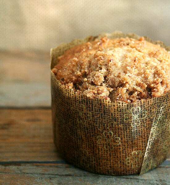 A coffeecake muffin on a table.