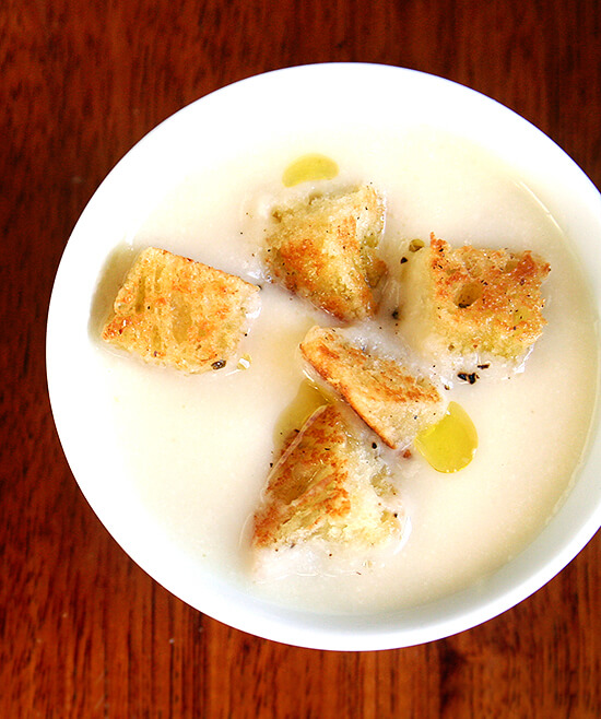 This recipe for cauliflower and apple puree soup calls for simmering cauliflower in milk with an apple and a few strands of pasta, the milk and apple included to temper the cauliflower's intensity, the pasta to provide just enough starch to ensure a creamy texture when the mixture is puréed. Both the purée and the soup are silky smooth in texture, and for containing just a few teaspoons of butter, taste incredibly creamy. // alexandracooks.com