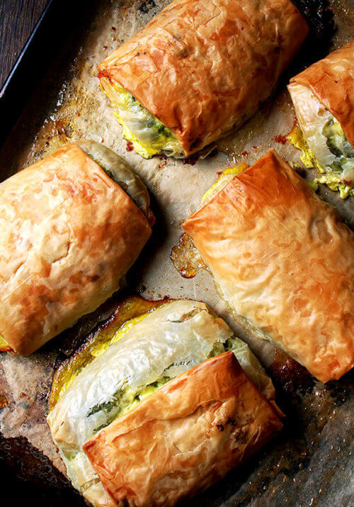When baked in strudel form, spanakopita assumes an almost breakfast croissant-like character, a perfect bundle of flaky pastry, egg, cheese, and greens. Yum. // alexandracooks.com