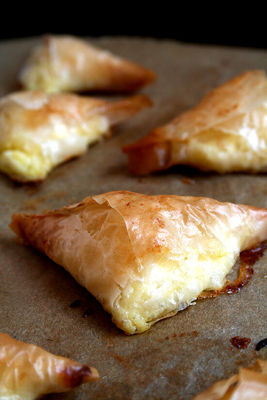 Tiropitas, cheese-and-egg filled fillo triangles, are always a party favorite. What's more, they're not complicated and can be made ahead and stashed in the freezer — perfect to have on hand for entertaining (including Easter Sunday!). // alexandracooks.com