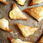 Just-baked tiropitas on a sheet pan.