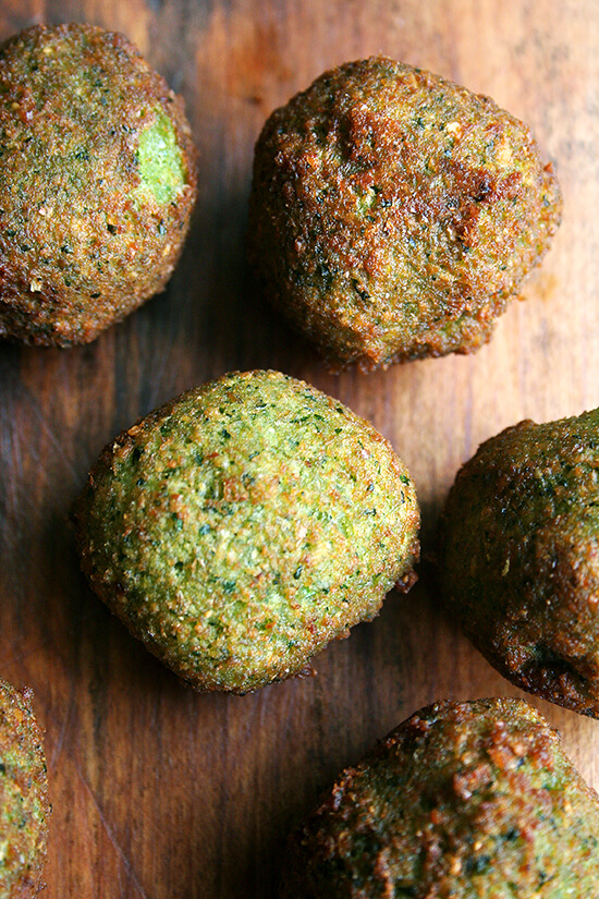 A mixture of dried fava beans, loads of cilantro and parsley, dried spices and lemon juice, these seasoned fritters are delicious. Homemade falafel is surprisingly easy to prepare, not to mention super delicious. // alexandracooks.com