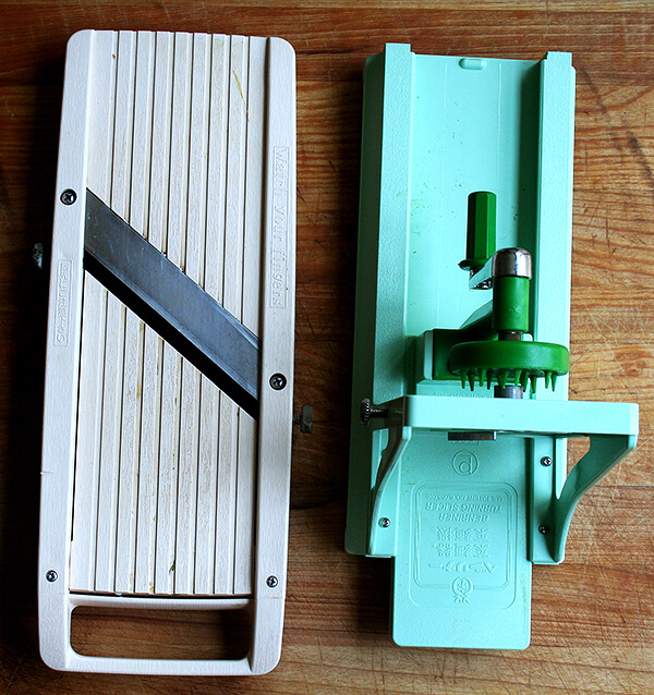 If you're in the market for a mandoline, I highly recommend the Benriner, but I would sleep better knowing you purchased a pair of kevlar gloves along with it. And if you have room for another gadget, the Benriner turning slicer does in fact have a place in the kitchen -- for certain vegetables it is a much safer and better tool to use than a mandoline, and if you're at all frightened by the idea of using a mandoline, the turning slicer might be the way to go. // alexandracooks.com