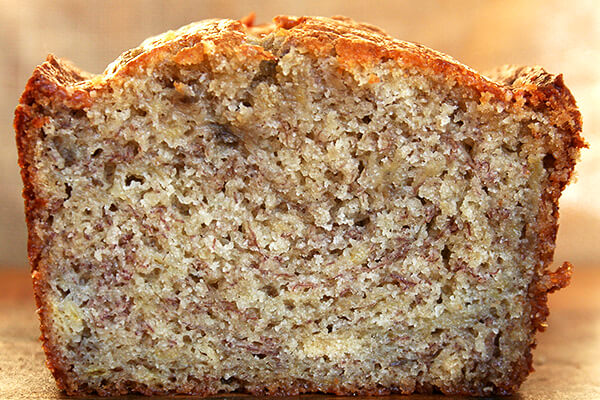 Cross-section of moist banana bread loaf.