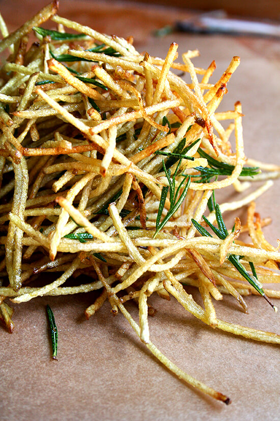 """Although my use of flavored salt extends to this single recipe — """"straw potatoes"""" seasoned with lemon salt (thanks to April Bloomfield) and fried with rosemary (thanks to Jamie Oliver) — the possibilities are endless. Salt might just become lemon salt from here on out. // alexandracooks.com"""