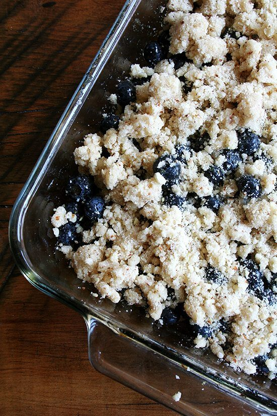 Like most crisps, this lemon blueberry crisp takes no time to prepare, and if you have a food processor, the topping — a mixture of flour, sugar, almonds and butter — comes together in seconds. The absence of oats and brown sugar in this crisp topping makes it particularly light and allows the lemon-sugared blueberries to really shine. // alexandracooks.com