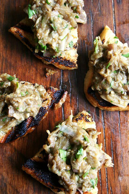 In this eggplant caviar, eggplant is roasted (as opposed to fried), which requires minimal oil, allowing the eggplant's sweet flavor to really shine. And after a gentle mashing with a fork, the eggplant's flesh becomes creamy, a perfect consistency to whip into a spread to spoon over grilled bread. // alexandracooks.com