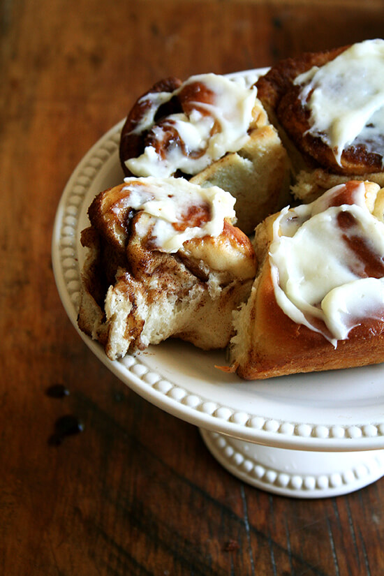 cinnamon rolls on cake stand