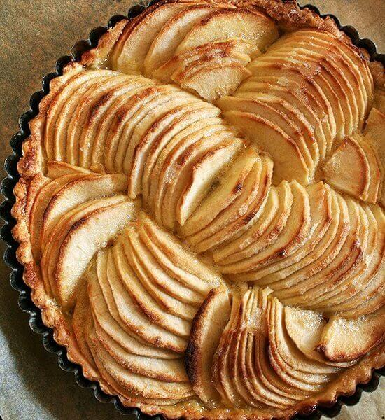 French apple tart in tart pan.
