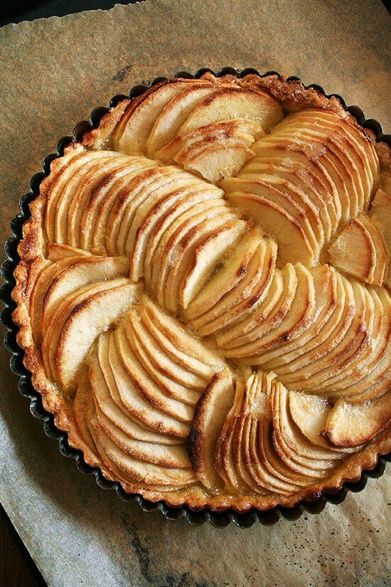 French apple tart in tart pan.