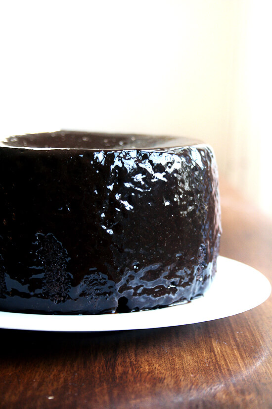 Double Chocolate Cake with Black Velvet Icing on a plate, ready to be sliced.