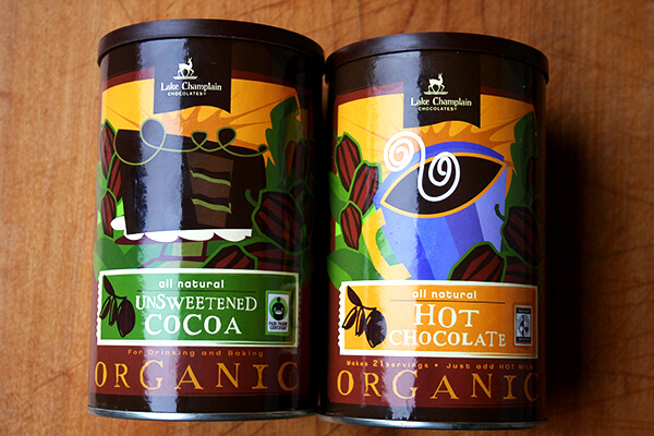 Two tins: Lake Champlain Chocolates Fair Trade Unsweetened Cocoa & Hot Chocolate.