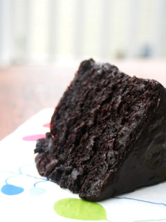 A slice of double chocolate cake with black velvet icing.