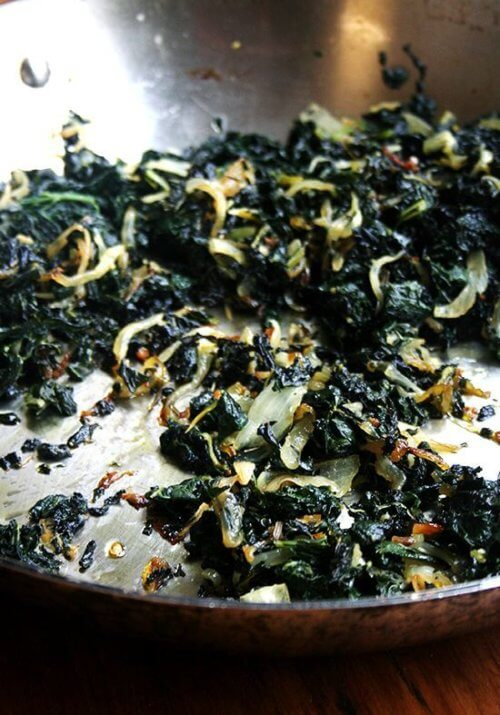 It's dishes such as this that make me understand (almost) how people can be vegetarian. In In this slow-cooked kale, kale is blanched first, roughly chopped and then sautéed over low heat for thirty minutes in olive oil with onions, garlic, rosemary and chile de árbol. It's almost black and slightly crispy when finished. It is sweet and addictive. // alexandracooks.com