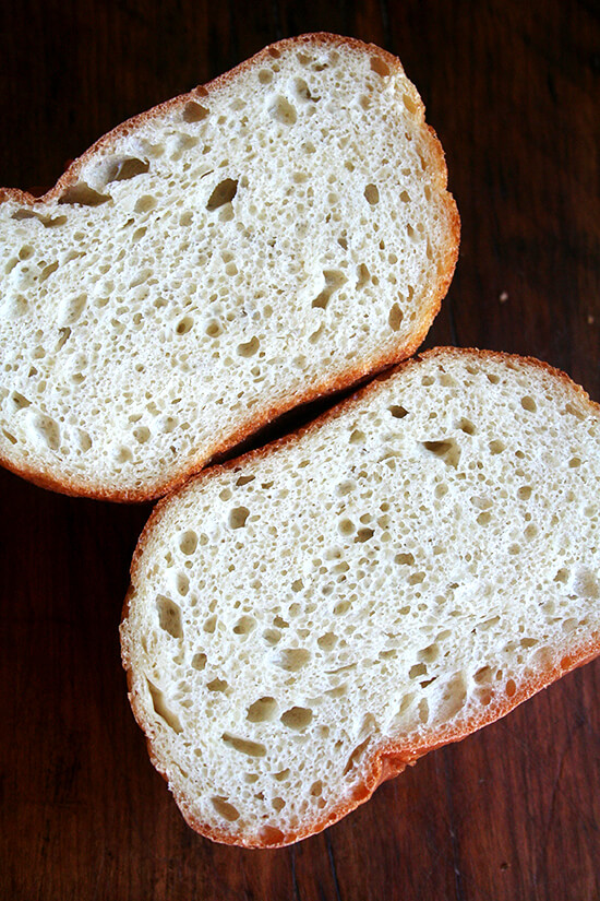 If you are in need of an amazing peasant bread recipe, look no further! This no-knead bread emerges golden and crisp. Spongy and moist with a most-delectable buttery crust, it's the perfect recipe! I would almost in fact be OK ending the blog after sharing this recipe, retiring altogether from the wonderful world of food blogging, resting assured that you all had this knowledge at hand. This bread might just change your life. // alexandracooks.com
