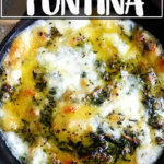 A skillet filled with baked fontina.