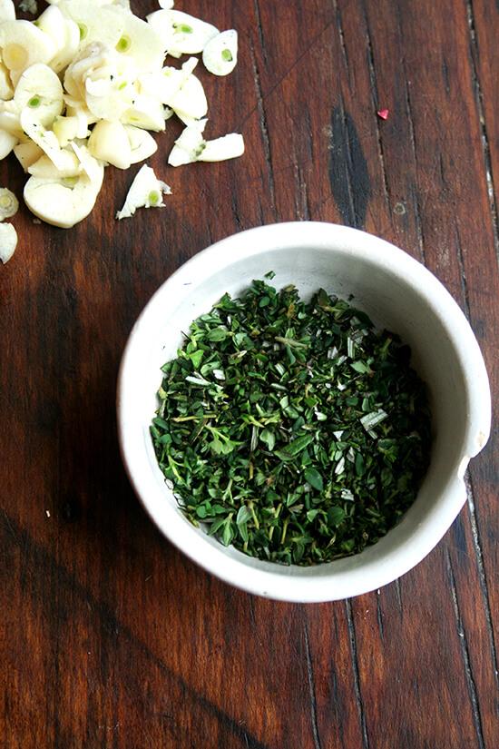 minced herbs and sliced garlic
