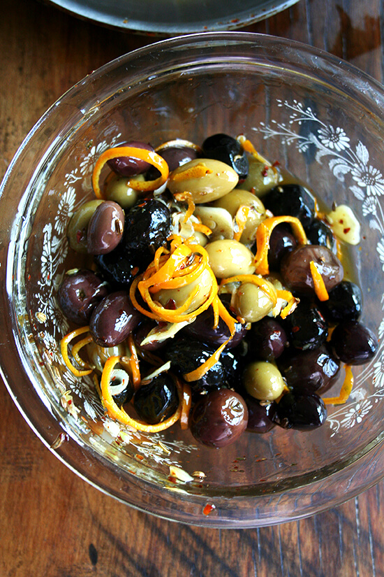 Marinated olives are about as easy as it gets as far as sprucing up the hors d'oeuvres spread goes — a little garlic and orange zest along with a few spices (crushed red pepper flakes and fennel seed) go a long way, and these flavor elements look so pretty in the serving dish as well. // alexandracooks.com