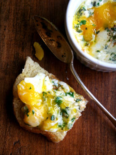 A piece of bread topped with baked (shirred) eggs.