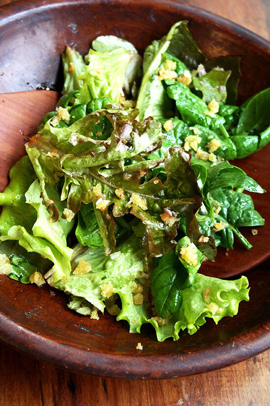 green salad with toasted bread crumbs