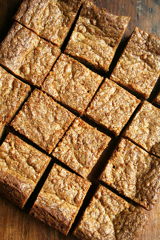 Cut brown butter blondies on a board.