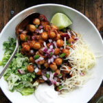 A bowl of chickpea taco bowls with toppings.