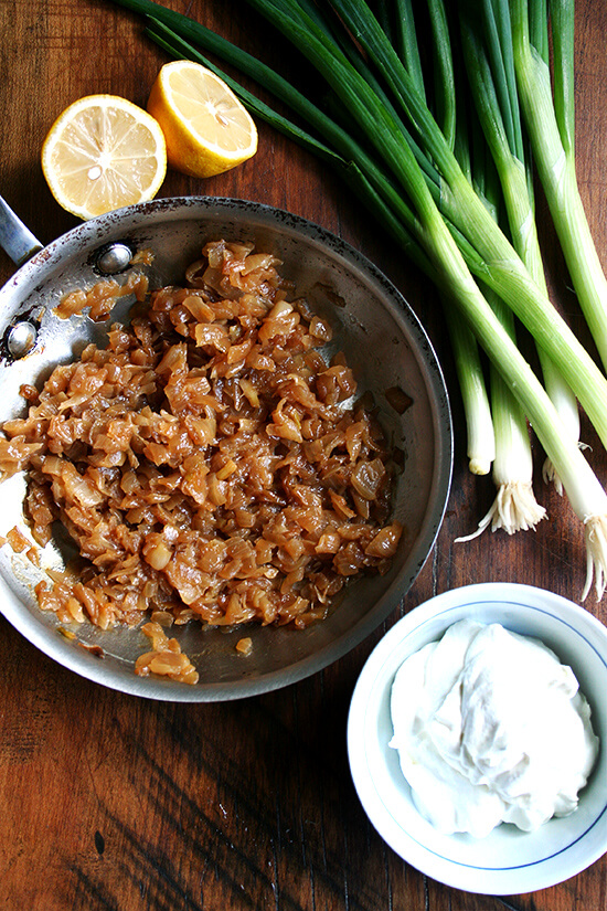 Sour cream and onion ingredients: caramelized onions, sour cream, scallions, and lemons.