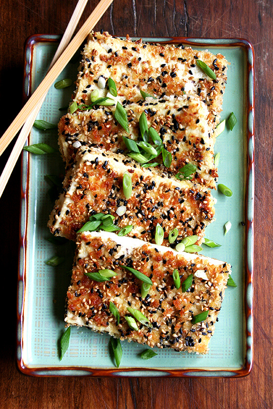 pan-fried sesame-crusted tofu on a platter