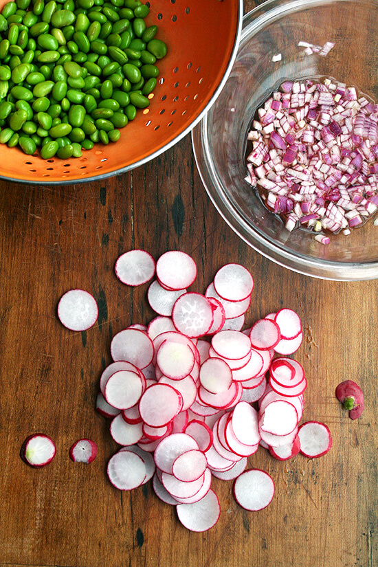 In this edamame and radish salad, radishes and edamame are in nearly equal proportion by volume, and the dressing is simple: equal parts olive oil and vinegar and a good sprinkling of salt — both the radishes and the edamame can handle it. It's a cinch to throw together. High in protein, light, colorful, satisfying — what's not to love here? And it's a great way to use up those CSA radishes to boot! // alexandracooks.com