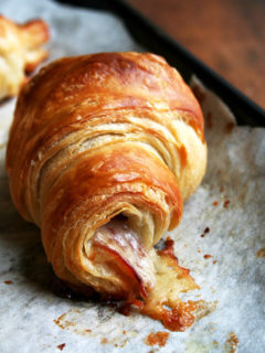 a baked ham and cheese croissant