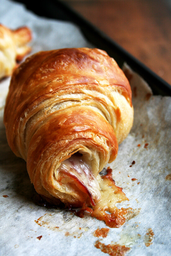 Layered with thin slices of prosciutto and batons of gruyère, this faux croissant dough produces crackly golden pastries with cheese oozing from the ridges and salty meat entwined in each flaky layer. The possibilities with this dough seem endless — croissants aux amandes, pain au chocolat, morning buns, plain croissants perhaps made for the sole purpose of making croissant bread pudding or French toast the following day? Perfect. // alexandracooks.com