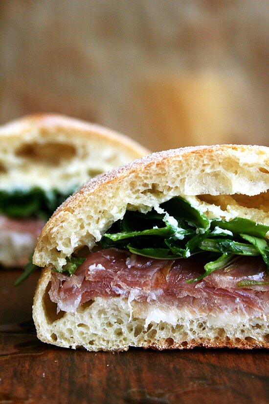"For Gabrielle Hamilton, the success of this prosciutto and arugula sandwich relies on a delicate balance, ""the perfection of three fats together — butter, olive oil, and the white fat from prosciutto or lardo."" Served on (faux) ciabatta bread, it's delicious. // alexandracooks.com"