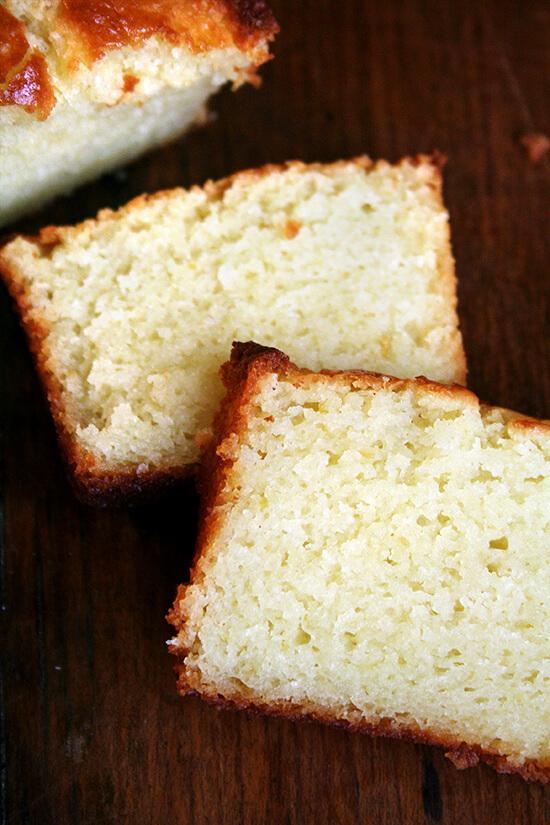 A mini loaf of lemon-ricotta pound cake, sliced.