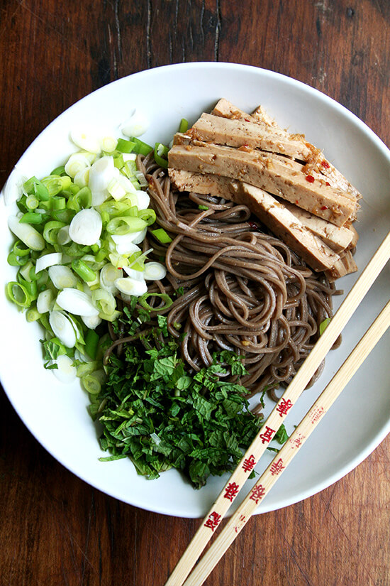 In this soba noodle salad, both the tofu and noodles are dressed with the same ginger and garlic soy-based dressing. It's a great dressing to use with any number of Asian noodles, but it excels in one area in particular: complete tofu domination. // alexandracooks.com
