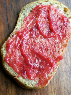 A slice of toast with rhubarb jam.