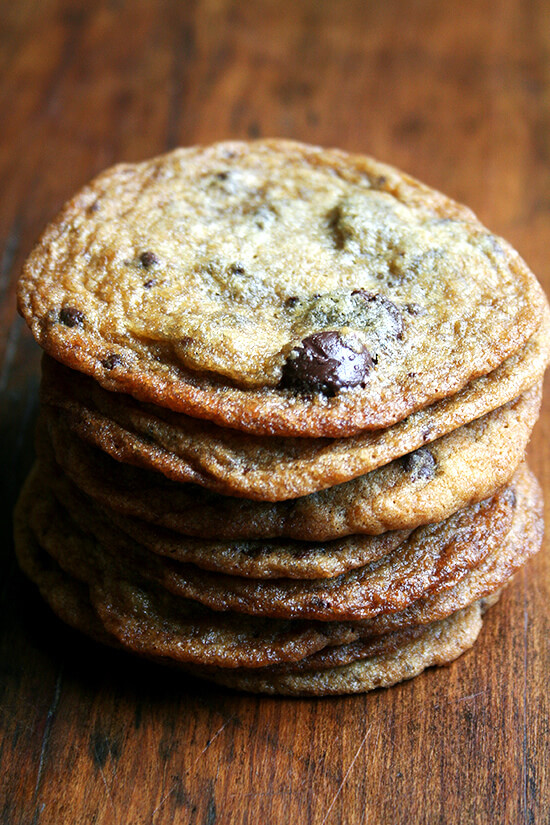 Crisp on the edges, chewy in the center, buttery with chocolate chunks throughout, these delicate cookies are enough to convert the thick-and-chewy-chocolate-chip-cookie lover in me forever. They are delectable and so easy to make. // alexandracooks.com