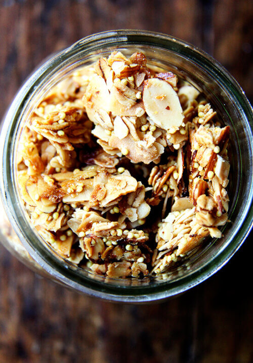 It comes as no surprise then that I absolutely adore this toasted muesli. Like granola, the oat mixture is toasted with a little oil — three tablespoons of olive oil — and a sweetener — a half cup of maple syrup. Like muesli, the mixture can be bulked up with dried fruit and puffed cereal or other grains and nuts. A healthy scoop of millet offers the nicest crunch, and the lightly toasted mixture, less sweet than granola, can be enjoyed with milk or yogurt alike. // alexandracooks.com