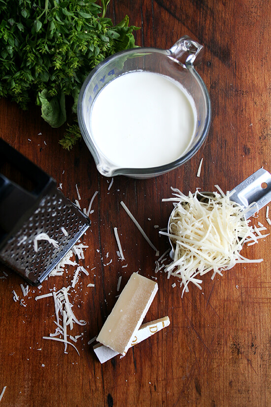 Overhead view of cream and shredded Parmigiano