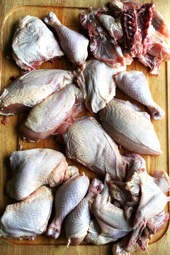 Two whole chickens, broken down into their various cuts.