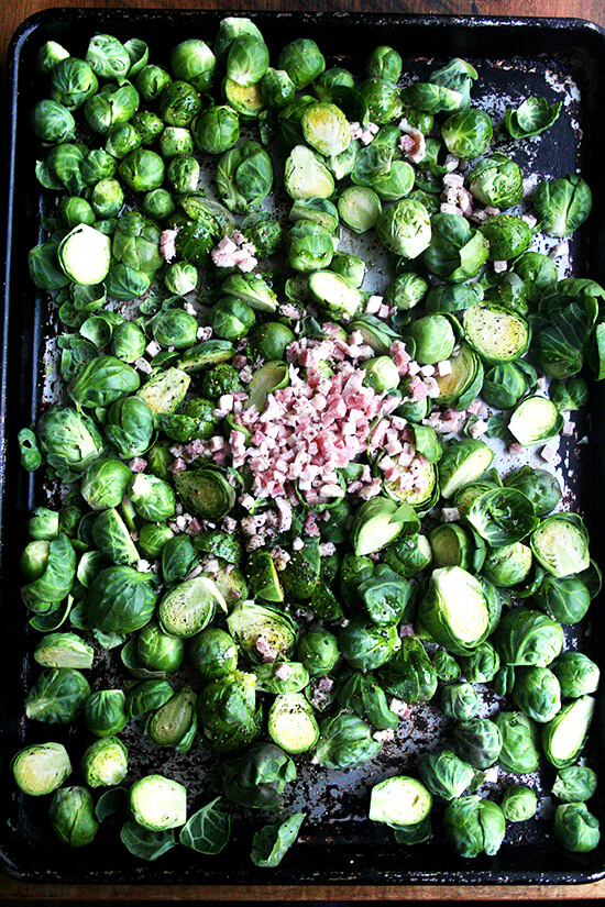 Brussel sprouts and pancetta on a sheet pan ready for the oven