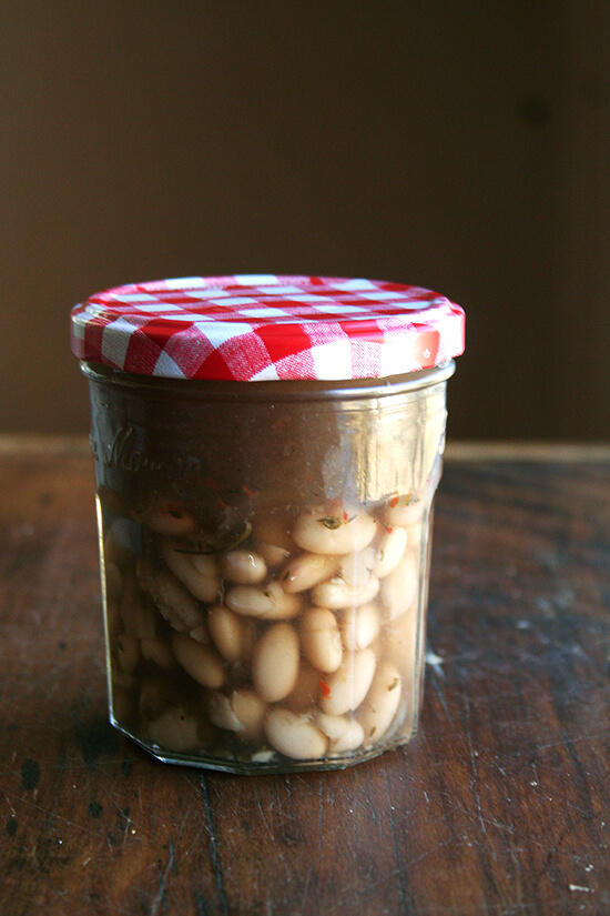 cooked white beans stored in cooking liquid