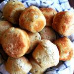 A basket of thyme dinner rolls.