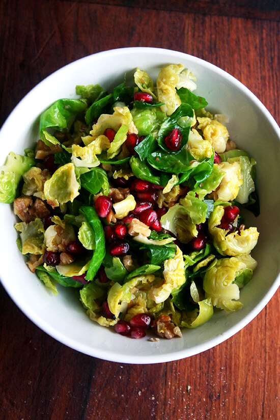 This brussels sprout salad, an amalgam of flavors and textures — sweet brussels sprouts, spicy jalapeños, crisp and tart pomegranate seeds, and crunchy toasted walnuts — will add a spot of color and a touch of freshness, a perfect counter to the creamy potatoes and the buttery bird on the Christmas dinner table. // alexandracooks.com