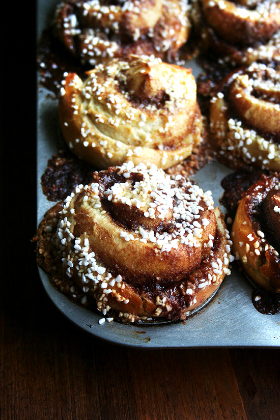 Baked in muffin tins, these irresistibly soft and sticky cinnamon rolls spiral vertically into snow-capped peaks with trails of cinnamon and sugar bursting through their doughy seams. // alexandracooks.com