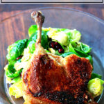 A plate with cheater's duck confit on top aside a salad.