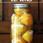 A jar of preserved lemons standing on a shelf.