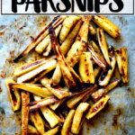 A sheet pan of just-roasted parsnips with chile-honey butter.