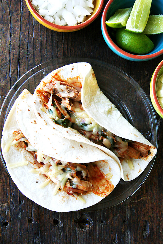 Tinga is something you should add to your repertoire. Made with only a handful of ingredients, tinga derives most of its flavor from chipotles in adobo sauce, which offer both smoke and heat. // alexandracooks.com