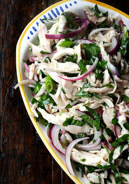 This no-mayo chicken salad is made with a simple dressing of olive oil and vinegar with big, plump pieces of chicken, lots of herbs, and a nice bite in the dressing. It's another nice no-mayo salad to serve at a summer gathering or to bring to a potluck. And there's only one thing to keep in mind while making it: less is not more. Don't be afraid to heap on those herbs. // alexandracooks.com